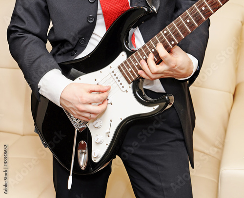 Businessman playing guitar