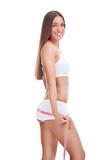 slim girl measuring her buttocks poster