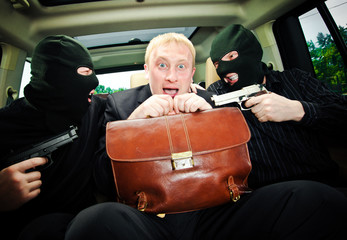businessman grasped in hostages.
