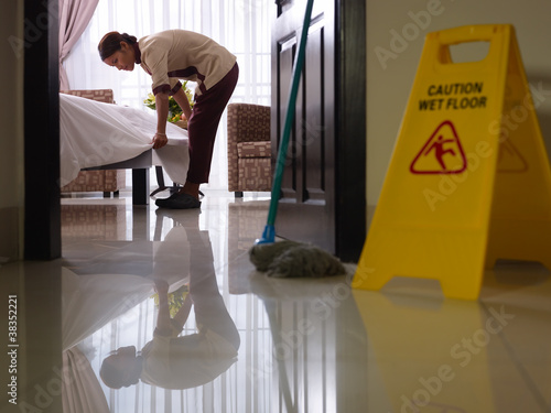 Maid at work and cleaning in luxury hotel room - 38352221