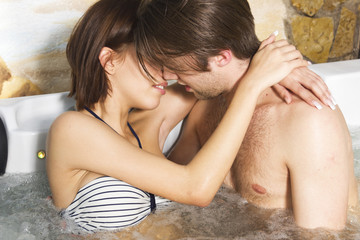 Passionate young couple in the jacuzzi