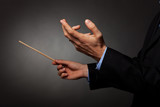 male music conductor directing