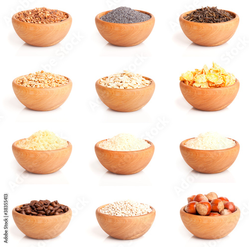 assortment of nuts and grits in the wooden bowl.