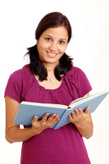 Indian student holding and reading a book