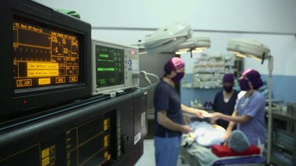 Operation room in clinic with medical staff during surgery