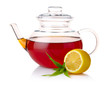 Teapot with black tea, green leaves and lemon slices isolated on