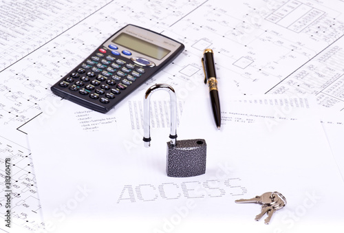 Open padlock, pen, calculator and inscription ACCESS