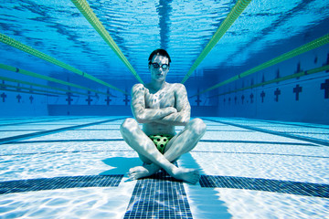 Swimmer in Pool Under Water