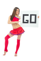 Cheerleader woman pointing her finger at a blank board