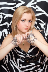 Lovely blonde stretches out her hands in chains