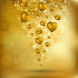 Abstract flying golden hearts