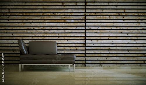 Wohndesign - braunes Ledersofa vor Holzwand
