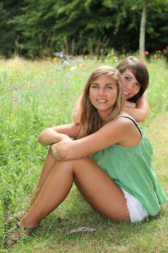 Friends sitting in a field