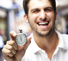 man holding stopwatch