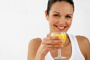 Brunette enjoying glass of orange juice