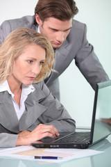 Executives with laptop computer