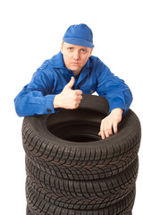 Mechanic with car tires at work