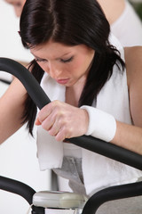 Woman using an exercise machine