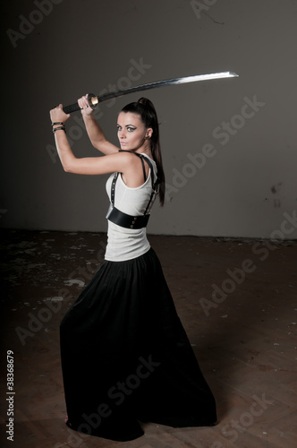 Woman Wielding Traditional Sword
