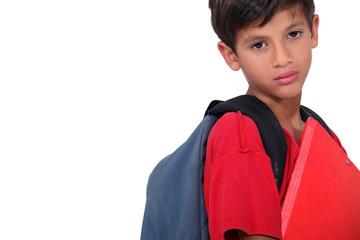 Sulky looking schoolboy