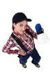Tradeswoman holding a spray gun