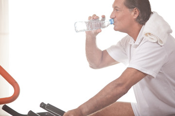 Man drinking water at the gym