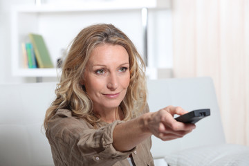 portrait of a woman with remote control