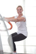 Mature woman working out at the gym