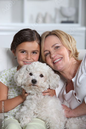 Mother, daughter and dog
