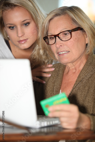 Mother and daughter calculating social security