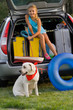 Travel,girl with dog ready for travel for summer vacation