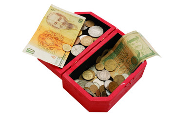 old banknotes and coins in wooden casket