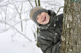 smiling boy in winter forest