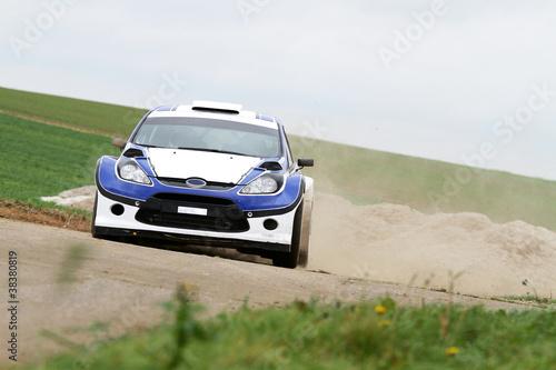 Foto op Canvas Snelle auto s voiture de sport dans le sable
