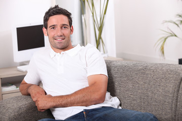 35 years old man sitting in a comfortable couch