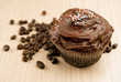 Chocolate cupcake and coffee beans