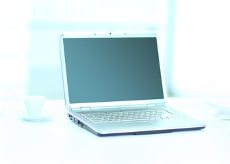 Demonstration of a laptop in the office of the front view.