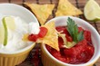 Salsa and sour cream with nachos