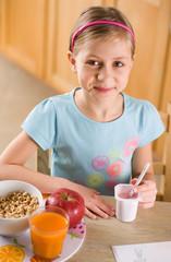girl eating yoghurt