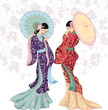 Two beautiful Chinese women with umbrellas
