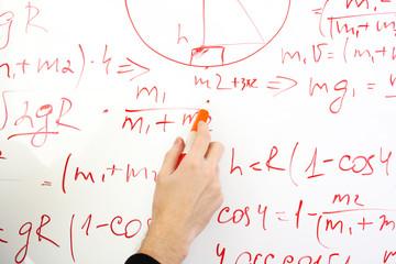 writing on the whiteboard formulas, closeup