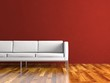 Wohndesign - weisses Sofa vor roter Wand