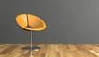 Wohndesign- orangener Sessel