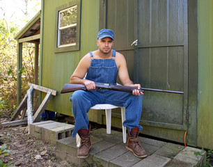 Man with Shotgun guarding his property