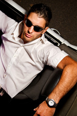 man with white convertible