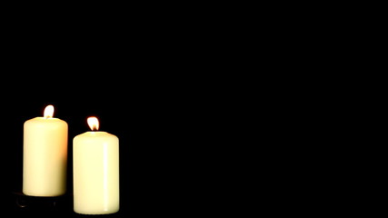 Candles on black background