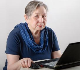 senior woman working on a laptop