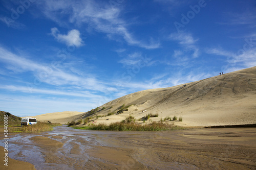 Dune Boarding at 90 Mile Beach on North Island, New Zealand.