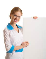 beautiful young female doctor holding a blank billboard