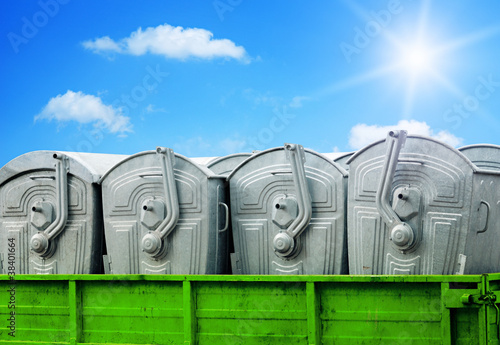 Garbage containers on blue sky background